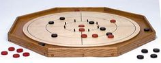 If you enjoy playing the strategy game Crokinole and you happen to have some woodworking skills, you might enjoy building your own board. Crokinole Board, Board Games, Boards, Diy Toys And Games, How To Apply Polyurethane, Old Fashioned Games, Board Game Template, Foam Paint Brush, Oak Plywood