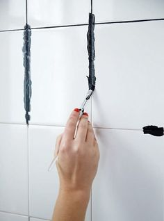How to DIY dye your white grout black! Such an easy DIY that can completely transform your bathroom or kitchen -- and no more dirty grout! Get inspired to make your own bathroom makeover happen with the tips and ideas from Bathroom Renovations, Home Renovation, Home Remodeling, Bathroom Makeovers, Kitchen Remodeling, Diy Bathroom, Dyi Bathroom Remodel, Ikea Hack Bathroom, Easy Bathroom Updates