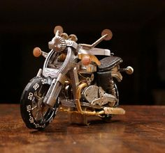Dan Tanenbaum, a 41-year-old Canadian, uses vintage watch parts to create unique miniature motorcycles