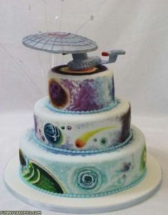 Star Trek 4 layer cake showing the quadrants of the universe and topped with the starship USS Enterprise.