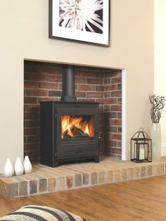 The Flavel No. 2 Multi fuel stove is a contemporary steel stove which features a large viewing window and is exceptionally easy to operate. Fireplace Design, Wood Stove Fireplace, Living Room With Fireplace, Home Living Room, Wood Burner Fireplace, Exposed Brick Fireplaces, Log Burner Living Room, New Homes, Fireplace Remodel