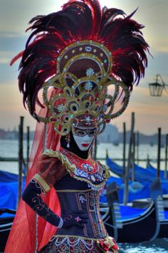Truly elaborate headdress with this mask.    Photo by Claudia Gadea    http://500px.com/photo/25989605