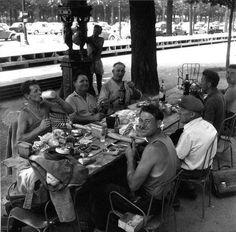 Le repas des travailleurs de la chausee- Champs- Elysees Paris 1959 by Robert Doisneau