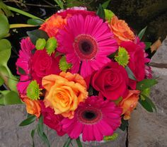 hot pink and orange gerbera daisy and rose bouquet
