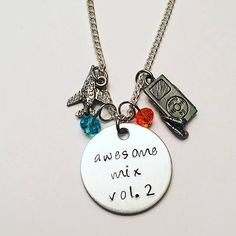 Awesome Mix Volume 2 Star Lord Peter Quill Chris Pratt Guardians of the Galaxy Rocket Raccoon Groot Gamora Yondu Charm Necklace #guardiansofthegalaxy #awesomemixvol2 #starlord #peterquill #chrispratt rocketraccoon #groot #gamora #yondu #handstamped #charmnecklace