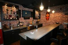 Retro Basement Bar Idea With Wooden Bar And Cabinet Finished In Black With Gray Countertops And Black Wall Mounted Wine Racks Also Exposed Brick Wall With Wall Poster Decors And Antique Pendant Lamps
