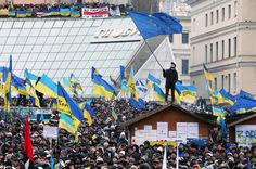 A Ukrainian protester waves a European flag during a pro-European protest rally on Independence Square in Kiev, Ukraine, on Dec. 8.