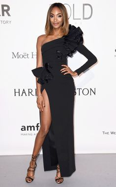 Jourdan Dunn from 2016 amfAR Cinema Against AIDS Gala Tres chic! The model opted for a unique stile with this one-sleeved black gown, accented with a shoulder and hip piece.
