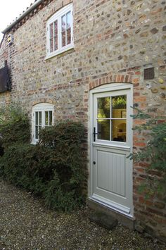 This French Grey stable door allows light to flood into the kitchen without compromising on the cottage feel. Cottage Front Doors, Cottage Windows, Cottage Door, House Front Door, House Doors, Timber Front Door, Painted Front Doors, Casement Windows, Windows And Doors