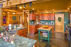 Green log home kitchen decorated for Christmas