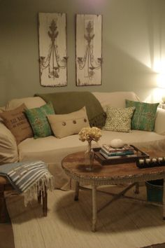 Pretty living room.  White on the walls, beige on the couch, floor and neutral coffee table.