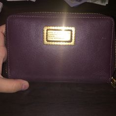 Marc Jacobs wallet Super cute. Has a pocket on the inside to hold a phone. Fits my iPhone 6 perfectly. Very spacious but not clunky. All around zipper. Marc by Marc Jacobs Bags Wallets