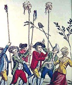 Peasants carrying aristocratic heads on spikes