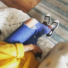 My laid back outfit today , baggy yellow jumper , ripped mom jeans and converse high tops