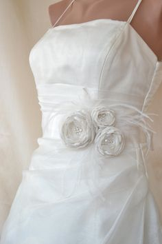 This gorgeous Bridal Sash Is handmade with satin fabric, rhinestone, pearls, feathers, organza.. Low price but high quality, Sash ribbon size measures 3 yards , please let me know if you would like to customize shorter or longer length. The ribbon is 2 1/2 inch(60mm) wide. It is handmade Wedding Sash, Bridal Sash, Wedding Flowers, Wedding Dresses, Belted Dress, Satin Fabric, One Shoulder Wedding Dress, Bridesmaid, Yards