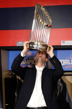 President of Baseball Operations for the Chicago Cubs Theo Epstein reacts with The Commissioner's Trophy after the Chicago Cubs defeated the Cleveland Indians 8-7 in Game Seven of the 2016 World Series at Progressive Field on November 2, 2016 in Cleveland, Ohio. The Cubs win their first World Series in 108 years.