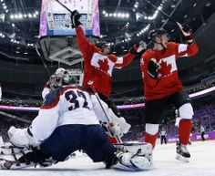 Men's hockey semifinals - USA vs. Canada  Canada forward Benn Jamie, left, reacts after scoring a goal in front of USA goaltender Jonathan...