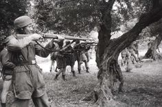 Crete, Greece, German paratroopers shooting local hostages, May-June 1941. Is that motherfucker at the front smiling?
