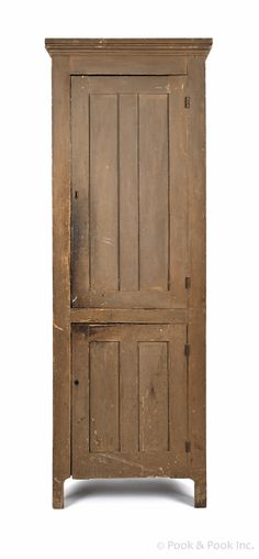 """Painted pine chimney cupboard, ca. 1820, retaining an old brown surface, 79"""" h., 25 1/2"""" w. - Pook & Pook"""