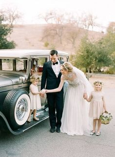 proud flower girl with basket holding bride's hand @myweddingdotcom