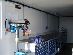 This shipping container was developed by Container Care in Liverpool and has been fitted out with electric points, internal panelling, generators, worktops, ventilation and machinery. More information can be found here: