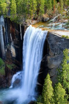 Its waterfall season in Yosemite National Park. This is the time of year when snow melt reaches its peak and the waterfalls are most impressive. I captured this image of Vernal Falls from a vantage point high on the John Muir Trail. Many people photograph these falls from below, on the Mist Trail, but this perspective is more impressive in my opinion (and you don't get wet trying to take this shot).  Best Viewed Large On Black