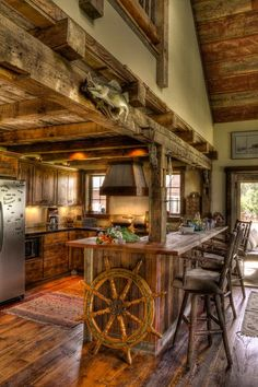 I like the idea of having a lowered kitchen ceiling in a barn-style home ... differentiates the space and cozies it up a bit.