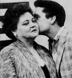 Elvis and Gladys in the U-S army office in Memphis ready for his army induction