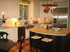 White cabinets with dark island?? Hmmmm........