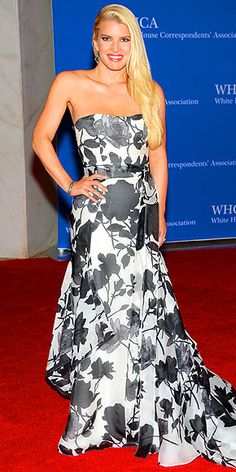 White House Correspondents' Dinner 2014: What the Stars Wore | JESSICA SIMPSON | After slipping back into her Daisy Dukes just over a month ago, Jessica shows off her svelte figure in a strapless floral-print Carolina Herrera gown.