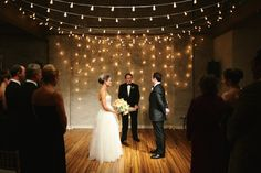 Amber uplighting, champagne draping, Italian string lighting, dance floor wash, and pinspotting for a wedding at Front & Palmer in Philadelphia, PA. Photos © Lindsay Hite/READYLUCK. Lighting by Synergetic Sound and Lighting.