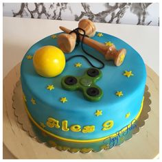 Cake with kendama and spinner - cake by Felis Toporascu