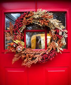 5 DIY Ideas for Fall Wreaths; Made the yarn wreath that is listed here. It was pretty easy, and looks great hanging on our door. :)
