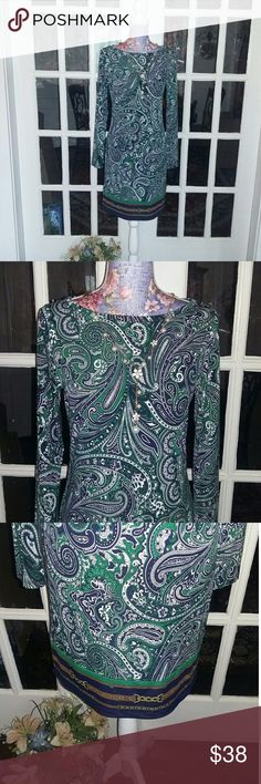 Michael Kors Blue &Green Paisley Dress EUC Beautiful dress by Michael Kors size S. The colors are an emerald green navy blue and white in a paisley design. The bottom of the dress has a different design of a brown chain. The material is polyester and spandex so it has a lot of stretch to it. It is a slipover style . Sleeves are long. I find no defects with this dress. It will be an excellent addition to your Posh closet. Thank you for visiting my castle. Michael Kors Dresses Long Sleeve