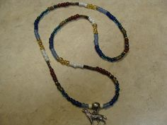 Tile crow beads with sterling silver wolf pendant... $15