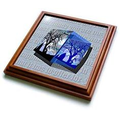 A note to a Dad behind a photo on a 3D Repousse of a tree Trivet