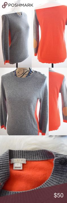 J. Crew Merino Wool Colorblock Pullover Beautiful wool red and gray pullover crew neck sweater Great pre-owned condition Size Small Three-button closure at neckline Elbow pads in contrasting tan faux-suede Hand wash cold 37% Viscose, 35% Nylon, 28% Merino Wool  From the Fall 2014 collection J. Crew Sweaters Crew & Scoop Necks