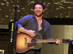 Chris Young performing in West Valley, Utah...at this point, Chris might as well just take that shirt all the way off.... :-P