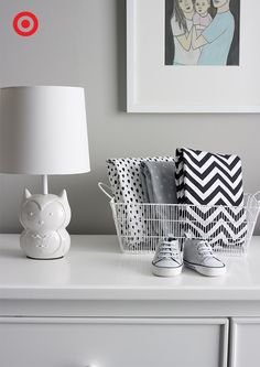 A soothing black-and-white monochromatic nursery creates a stylish room for Baby. Soft gray walls set off with a white dresser and crib create balance, while accessories with bold patterns make the room pop. Plus, this sweet owl lamp adds a warm, glow for cuddling, feeding or late-night diaper duty.