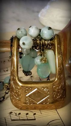Brass belt buckle adorned w larimar, aquamarine, amazonite & blue chalcedony hangs from a brass chain studded w/ the same beads. https://www.facebook.com/pages/Take-II-Vintage-Treasures-Upcycled-Jewelry/276500575881676