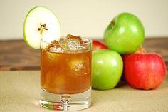 1-1/2 ounces Captain Morgan Black spiced rum  1/2 ounce vanilla vodka  3 ounces fresh apple juice  Ice