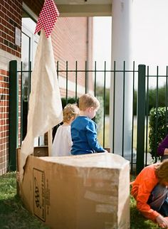 David helped me create a sailboat out of a cardboard box for the kiddos to play in.  I don't have a picture for this, but I also had fishing poles made out of dowel rods and string for them to pretend to fish with.