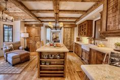 Ceiling Beams And Chandelier With Rustic Kitchen Backsplash For Rustic Kitchen Cabinets Also Kitchen Cabinet With Alderwood Cabinets And Farmhouse Sink Plus Granite Countertops With Wood Flooring