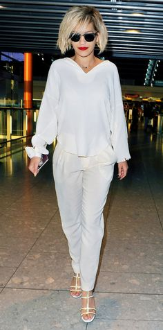 If you're a heels-only kind of gal, wear a white sandal a la Rita Ora, who rocked her pair of Jimmy Choo Thistle Sandals at Heathrow Airport. // #celebritystyle