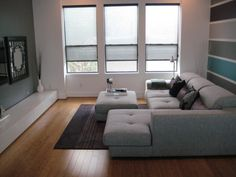 Minimal living room in a small area: Not a fan of the striped wall, however.