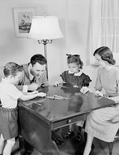 1950s Family playing matchsticks.