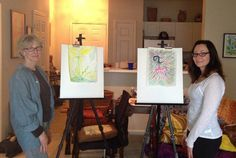 """Proudly displaying their finished pieces from my #Intuitivepainting workshop: """"Women Creating from Source""""."""