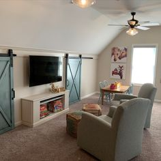 A playroom above the garage? No problem. Add 2 beautiful  barn doors with storage behind them, create a cozy place to curl up and read books with the kids , add a detachable custom made road car adventure board, a car shelving for storage, art work on the walls,  and here it is!  Playroom build and designed by Black Dog Design House Residential Interior Design, Commercial Interior Design, Commercial Interiors, Interior Design Services, Dog Design, House Design, Construction Contractors, Cozy Place, Playrooms