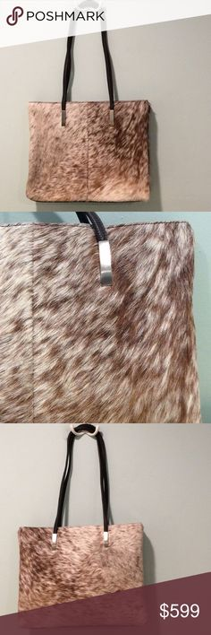 FSP Originals Capetown Boutique fur purse Fashion Sensitive Planet (FSP) Originals handbag. Boutique hand crafted bags, handmade in Capetown, South Africa. The fur is Wildebeest and colors are beautiful cream and caramel. Measures: Strap drop: 10 inches. Length: 12 inches. Height: 10 inches. Width at side:2.75 inches. One interior zip pocket with cell phone pocket. Main compartment has a zipper. Silver tone hardware. Simply gorgeous and excellent condition. New to Poshmark? Download the app…