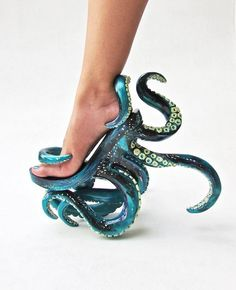 Shoe designer Kermit Tesoro, known for his wonderfully eccentric style, has crafted POLYPODIS, a pair of stunning high-heeled shoes that entwines each foot in a plethora of in a gorgeously shaded deep-sea blue tentacles.